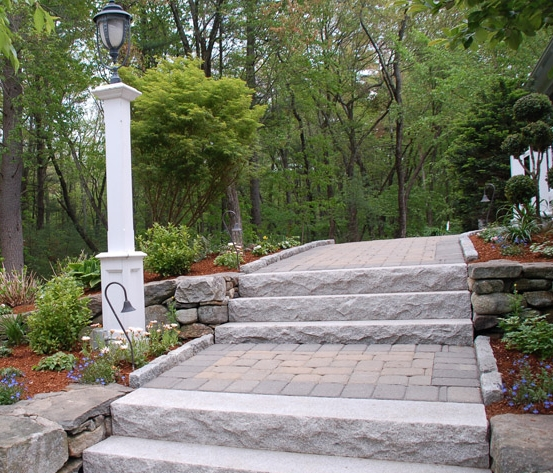 Granite steps manage evelation in paver walkway