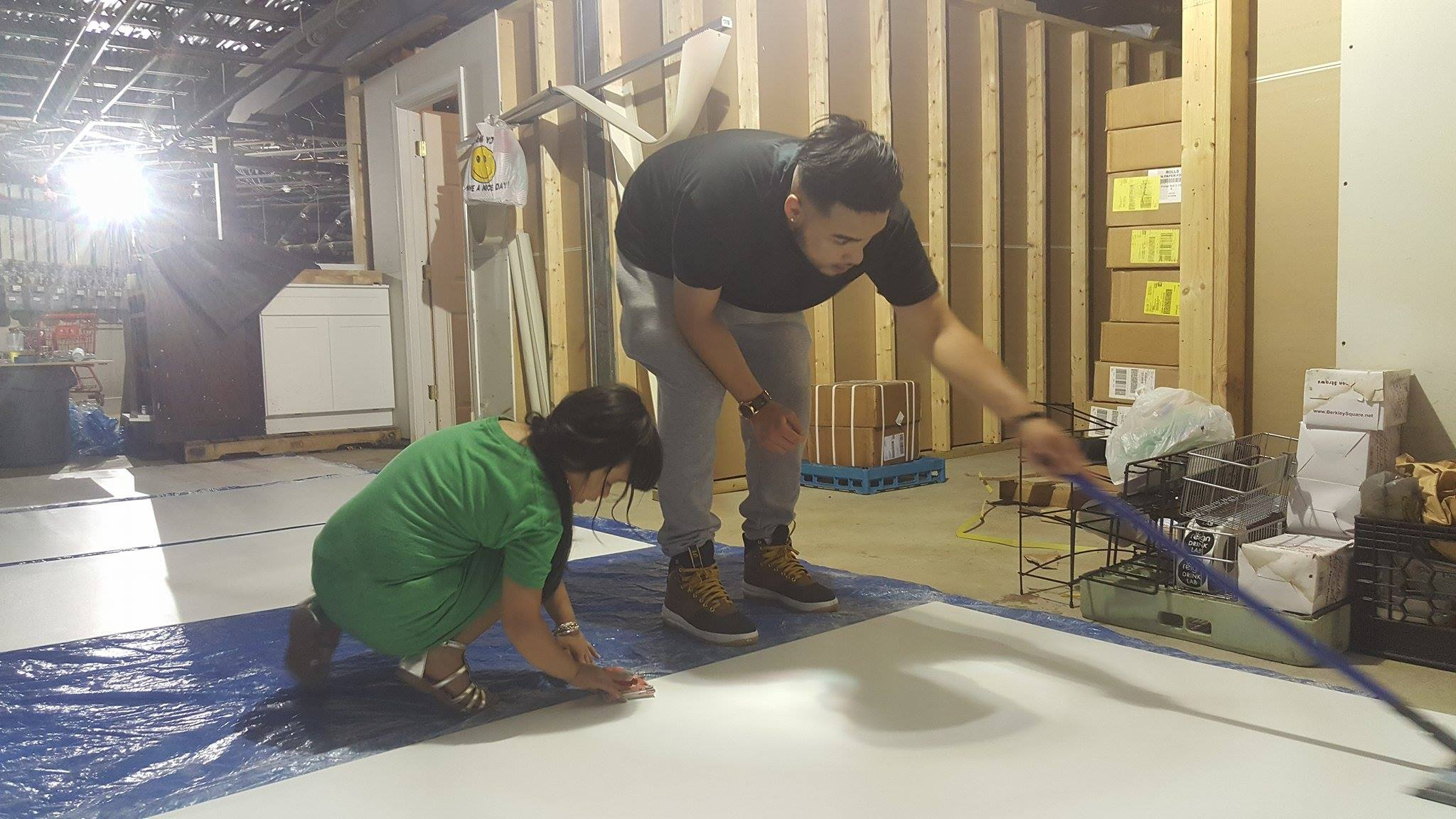 Left to Right: Kimberly and Tony Duo team hard at work sanding down the board and cleaning off the board!                      (Photo: Kathy)
