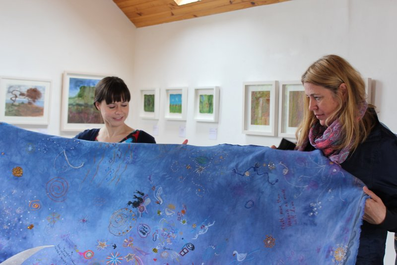 """Alison showing us a lovely interactive project they had running for the duration of the exhibition - visitors were invited to add their mark to the cloth, inspired by the poem """"He Wishes for the Cloths of Heaven"""""""