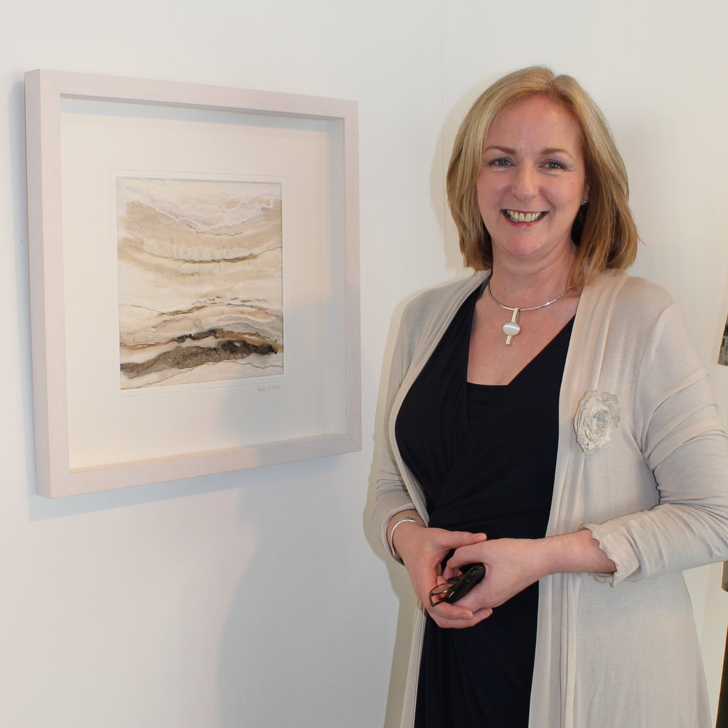Breda McNelis Textile Artist - pictured with 'Driftwood' at the Knitting and Stitching Show Dublin