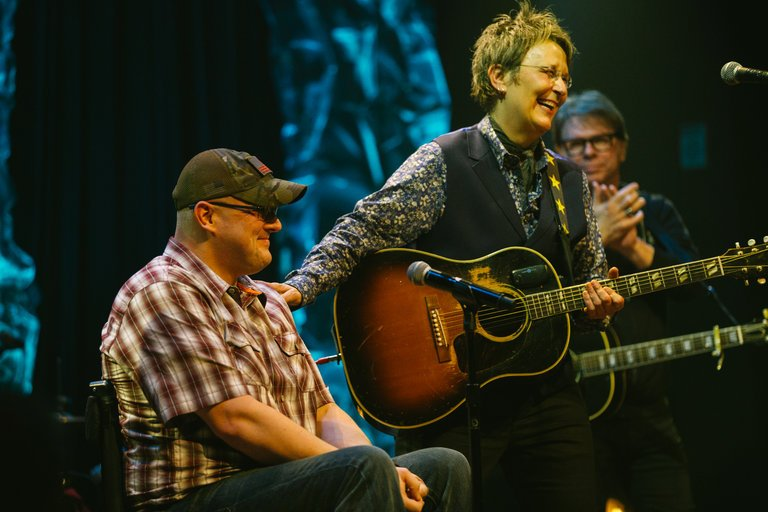 Mary Gauthier with Veteran and Co-Writer Josh Geartz on stage in Franklin, TN   Photo by Kyle Dean Reinford for The New York Times