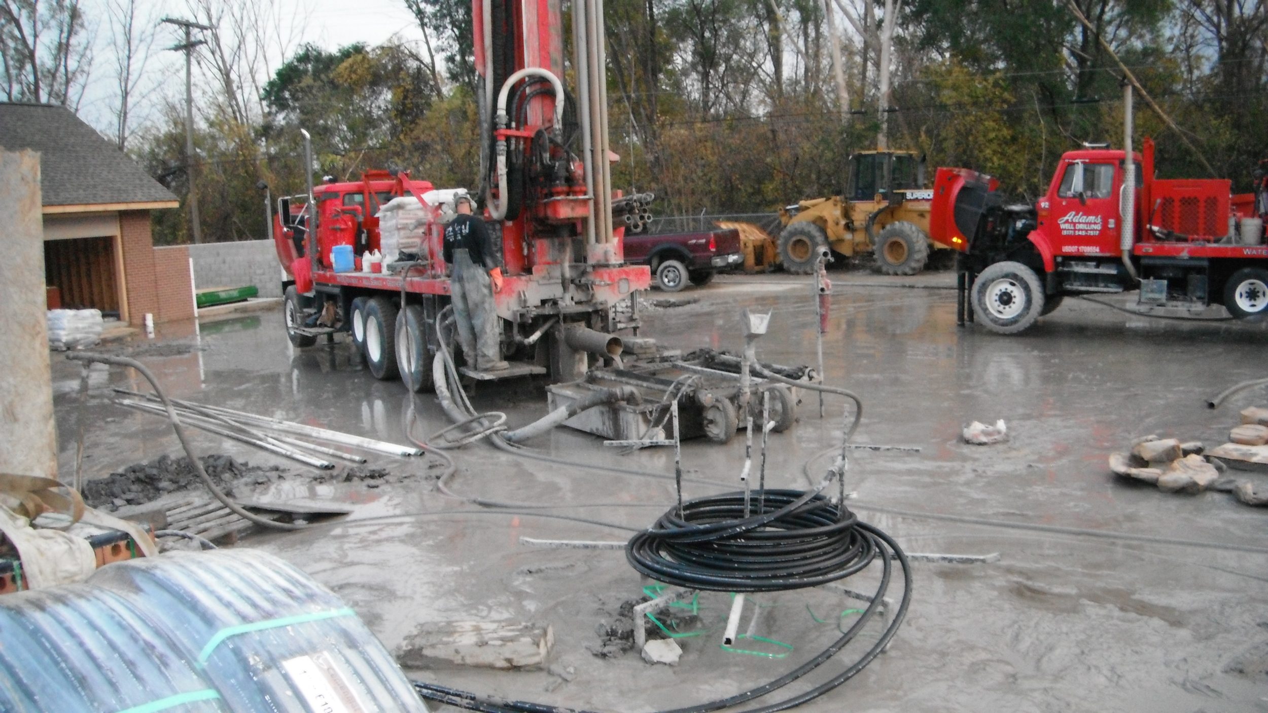 Geothermal Drilling Rig and 2 Pipes.jpg