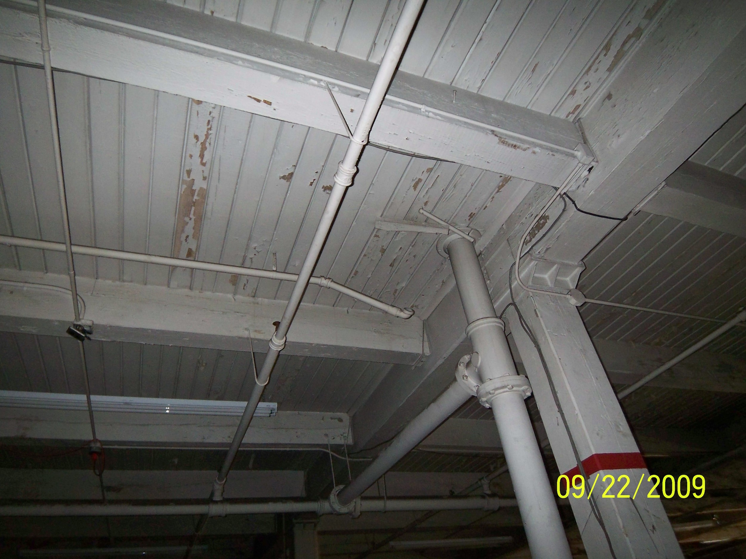 Timber frame and ceilings before restoration.