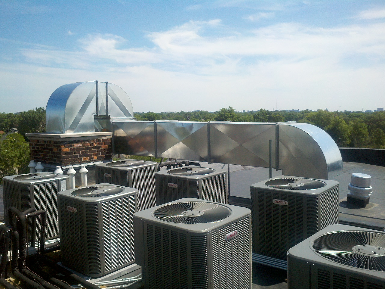 An innovative fresh air intake was designed by utilizing the building's original but presently unused chimney space.