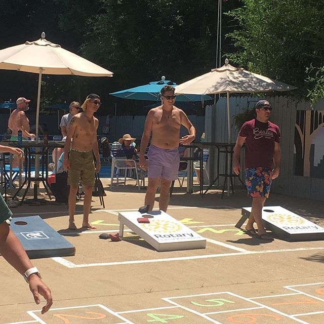 Rotary Club of Richmond corn hole boards in action at an LGRA benefit to support the swim team!