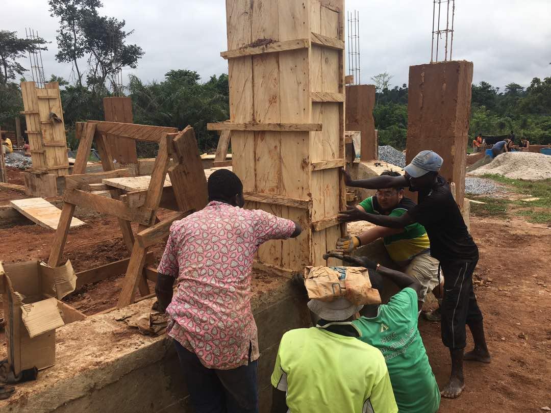 village men helping the team