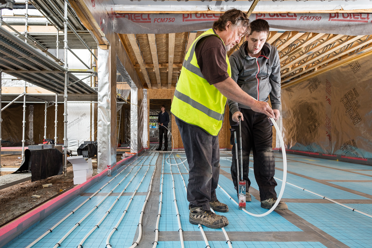 The Incognito Heat Co Installation team installing underfloor heating at this energy efficient home home in East Lothian