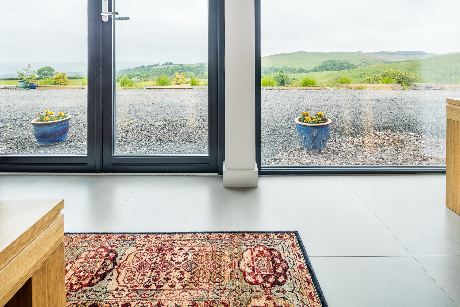 Underfloor heating allows for large areas of floor to ceiling glazing to capture light and take in the beautiful Perth and Kinross countryside