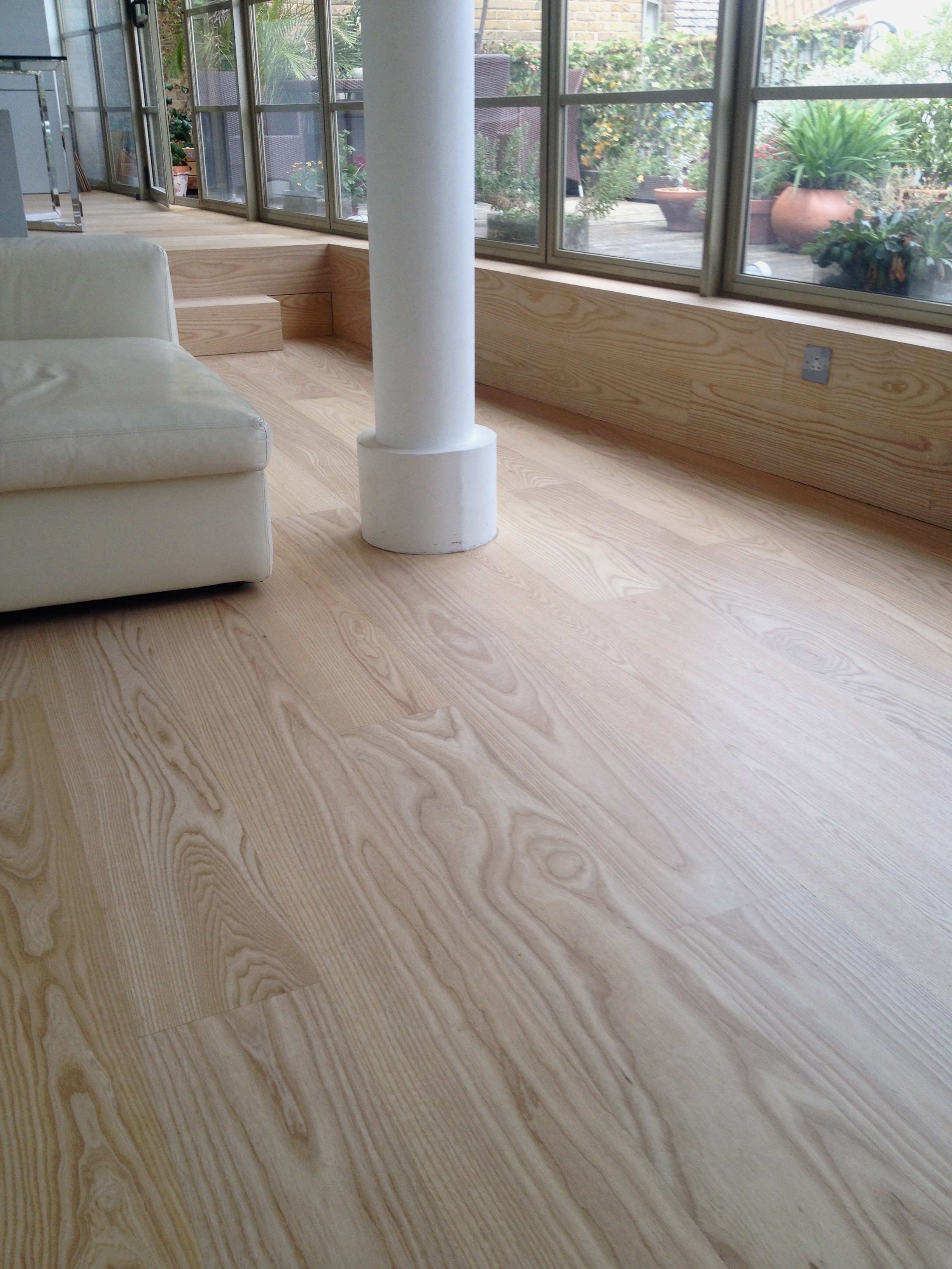 Ash floor with natural finish.