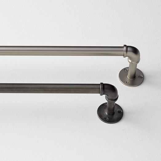 """Industrial Pipe Adjustable Rods (West Elm)   Aluminum in rubbed iron finish. 0.75"""" diameter, 4"""" projection. 28""""–48"""" (6.5-lb capacity), $69. 44""""–108"""" (20-lb capacity), $99."""