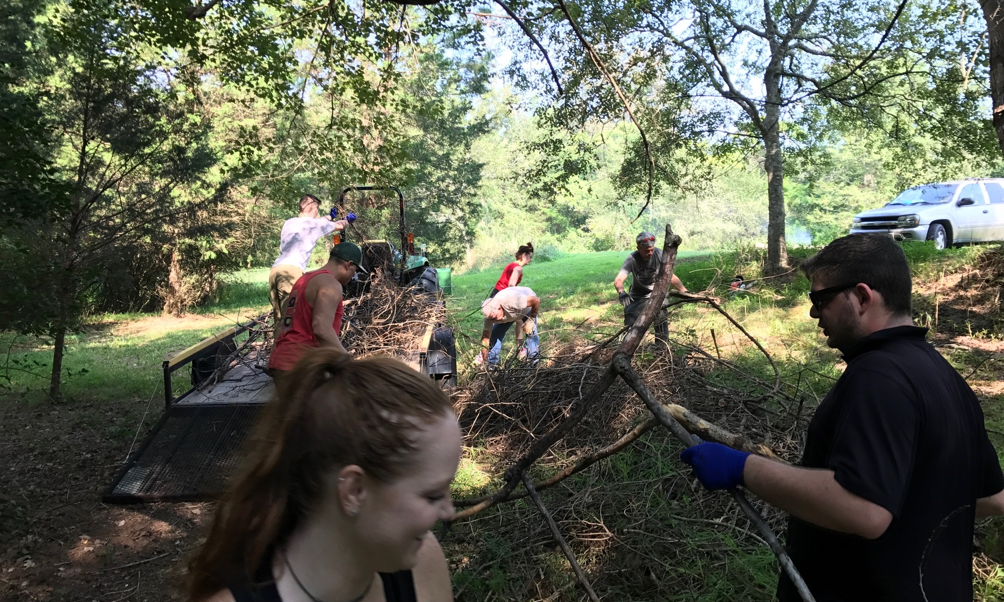 Volunteers clearing brush for our future retreat center!