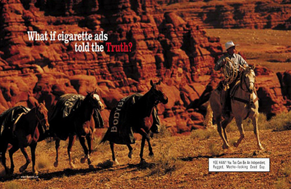 A truth campaign ad showing a Marlboro man with mules carrying body bags.