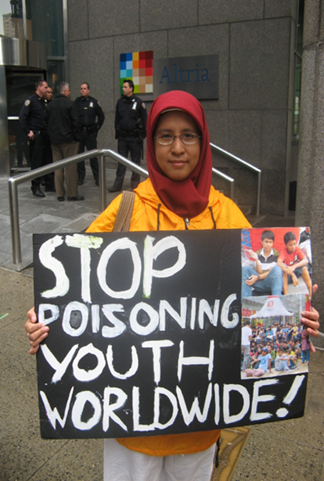 A youth representing the truth campaign demonstrates outside corporate tobacco headquarters