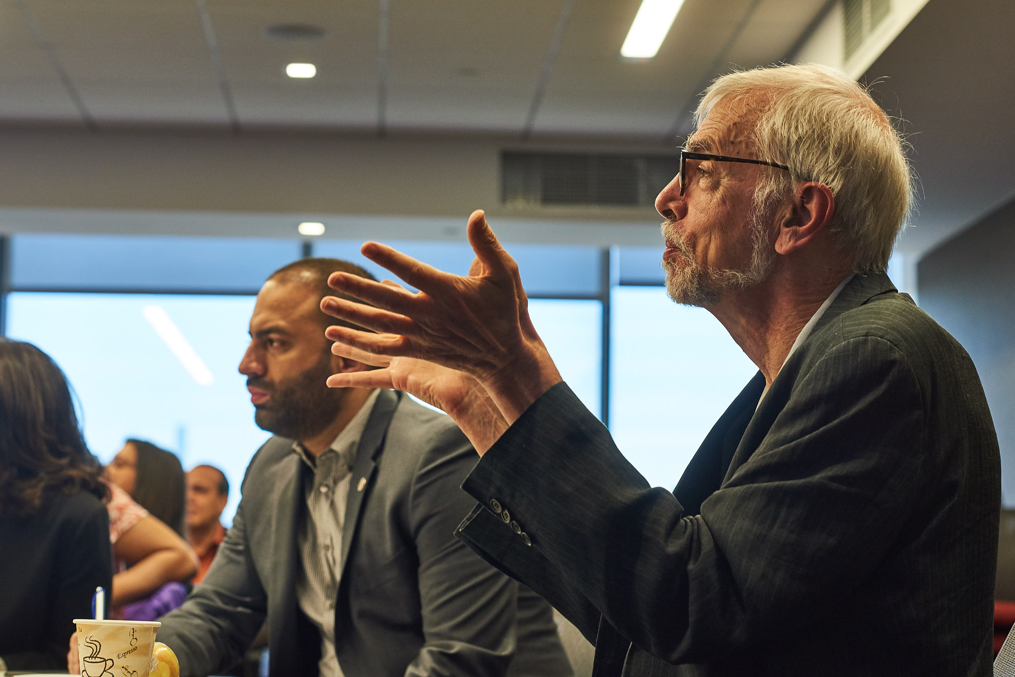 Nicholas Freudenberg, Director, CUNY Urban Food Policy Institute, in discussion with store operators and representatives from city government, philanthropy and nonprofit organizations addressing the food needs of New Yorkers. photo credit:  Reeve Jolliffe