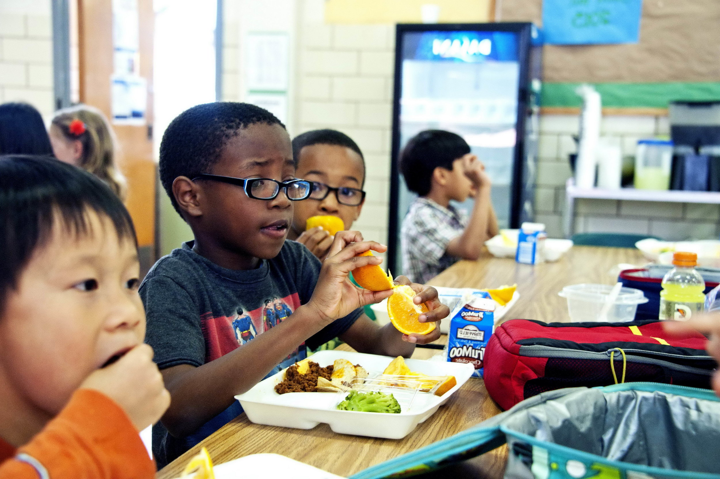 Child eating school lunch. Public domain