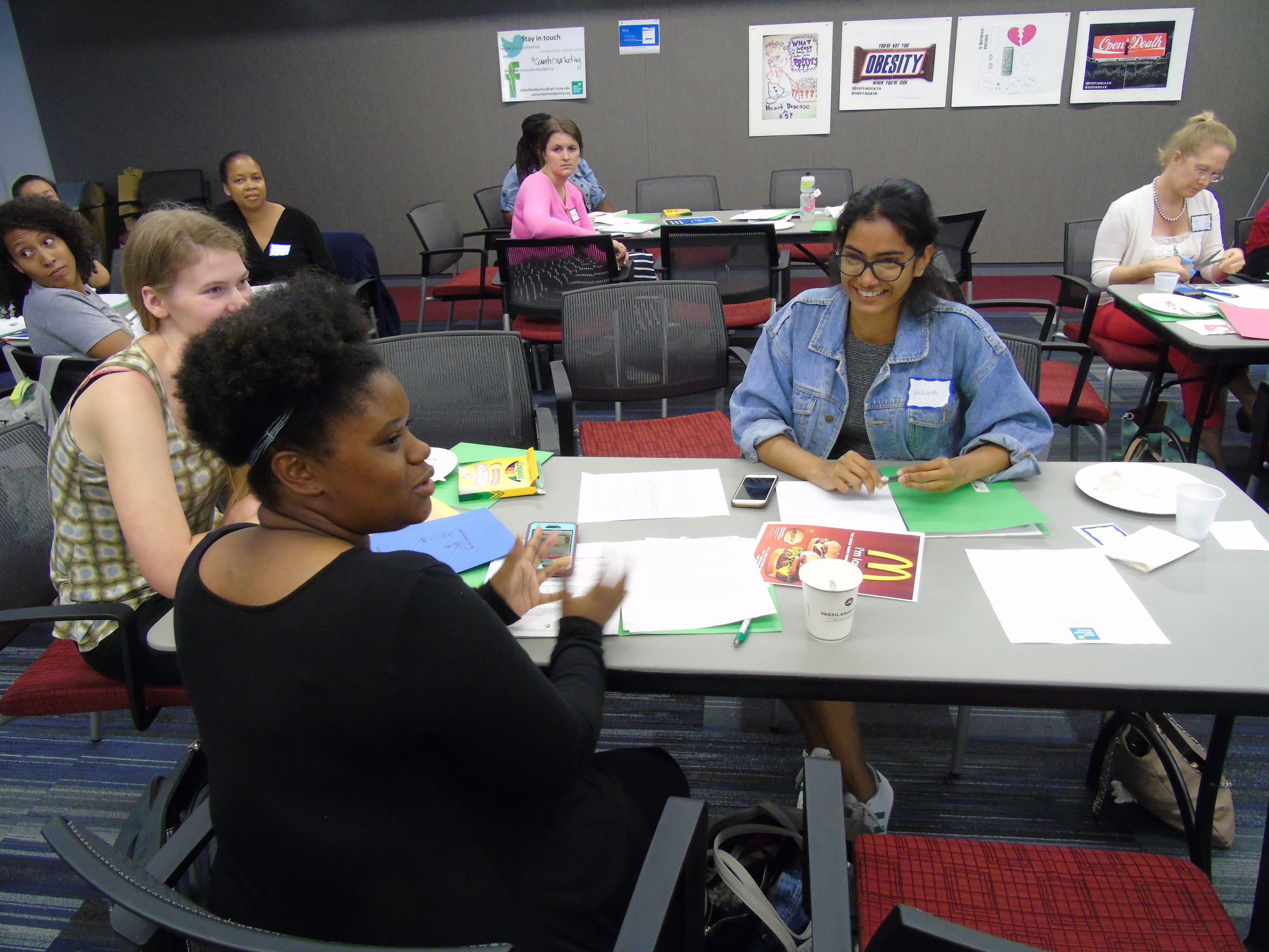 Participants from the Countermarketing Staff Training Program having a discussion.