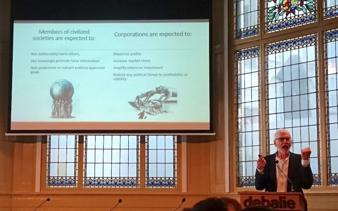 Above, Nicholas Freudenberg speaks on corporations and health at DeBalie, a public lecture hall in Amsterdam.