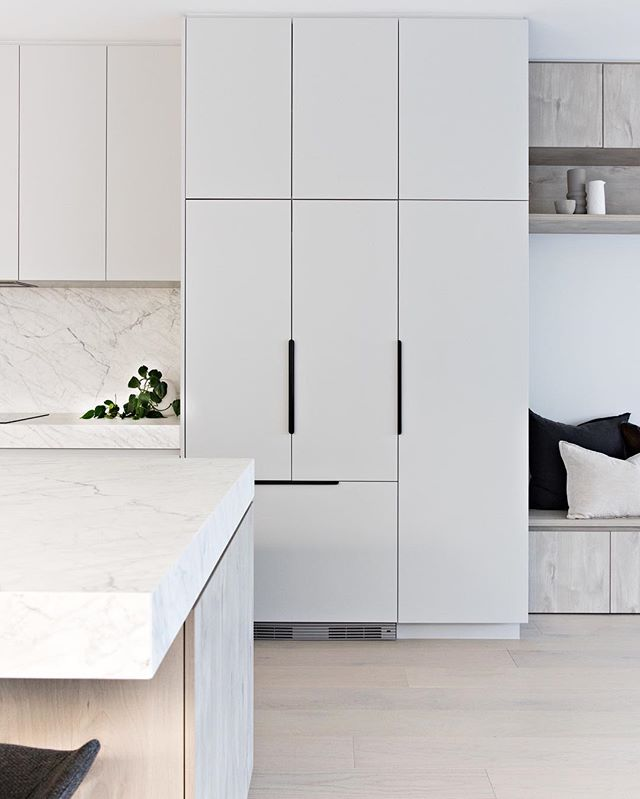 The integrated fridge // ⠀⠀⠀⠀⠀⠀⠀⠀⠀ A slick and minimalist inclusion to any kitchen. In our Teal Ave townhouses we used the RS90A1 model from @fisherpaykel that allows the cabinetry to take centre stage 👏🏻