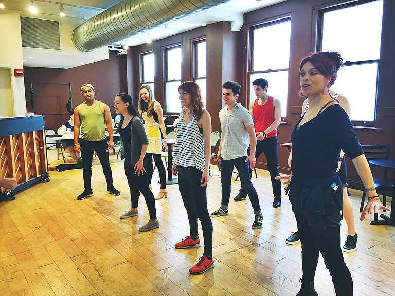 The cast of CITY OF LIGHT rehearses the finale! From left to right: Darren Bunch, Kimberly Immanuel, Keri Safran, Valarie Pettiford, Katy Wilson, Anthony Norman, Zach Schanne, Jack Cotterell's shoulders.