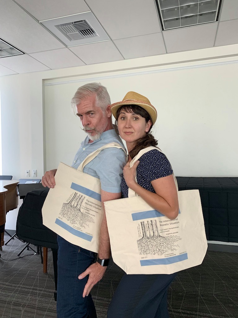 Phil and Andrea with their International Phonetic Situation Tote Bags, designed by Simon Masterton!