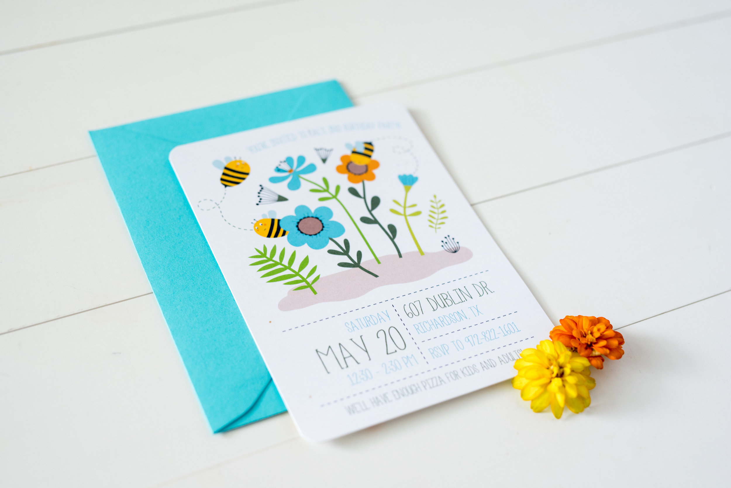 Less is always more! Protip: Gotta garden outside? Go grab some flowers! Our yellow and orange zinnias did the trick for this simple bee themed birthday invitation. Photo by: Lexie faucher photography