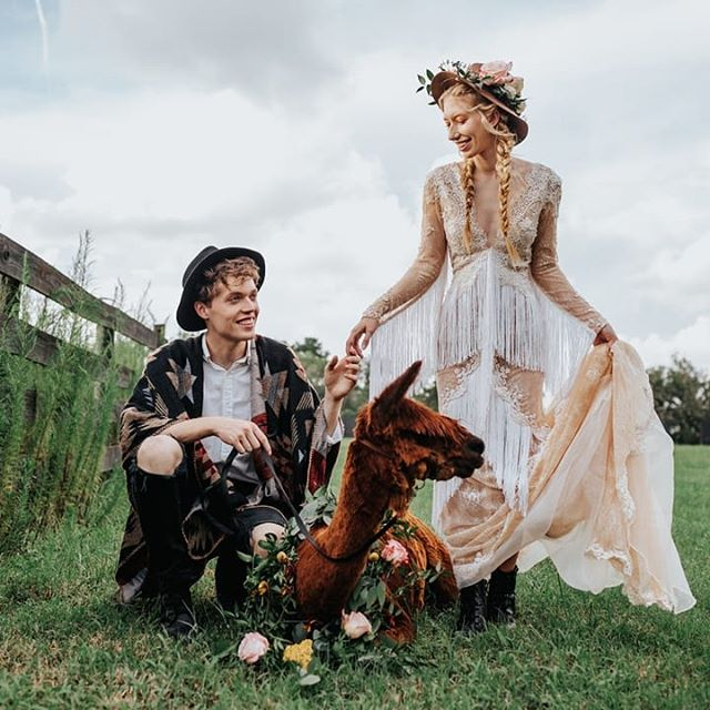 How adorable is this trio?! And yes, I am totally including the llama. I mean these two did, why shouldn't I?! 🦙🖤 ⠀⠀⠀⠀⠀⠀⠀⠀⠀ And have you checked out all the incredible photos from today's feature at @greenweddingshoes because if not... now's your chance! All that boho fringe and floral is waiting for you. [link in bio] ⠀⠀⠀⠀⠀⠀⠀⠀⠀ Photographer | @angieandmarko Stationery | @handsofhollis Calligraphy | @wordsmadesemple Bride | @imlaurenallen Groom | @nathangwaters Hair + Makeup | @mistibluday Dress | @siradpion Cake | @annahightower Signage | @chicsigndesigns Florist | @fernandcurldesigns Ring | @rawbyoliviamar Decor | @flockdecor Ring box | @thevelvetgardenringbox Video | @uptownandmore Venue | @theedisonweddingsevents