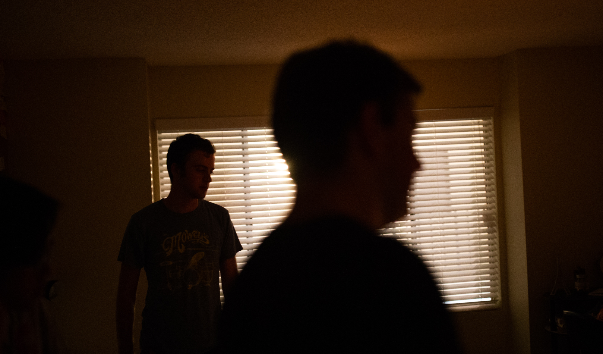 2nd assistant camera Brady Petrik, left, and director Tyler Aquilina plan shooting the next scene.
