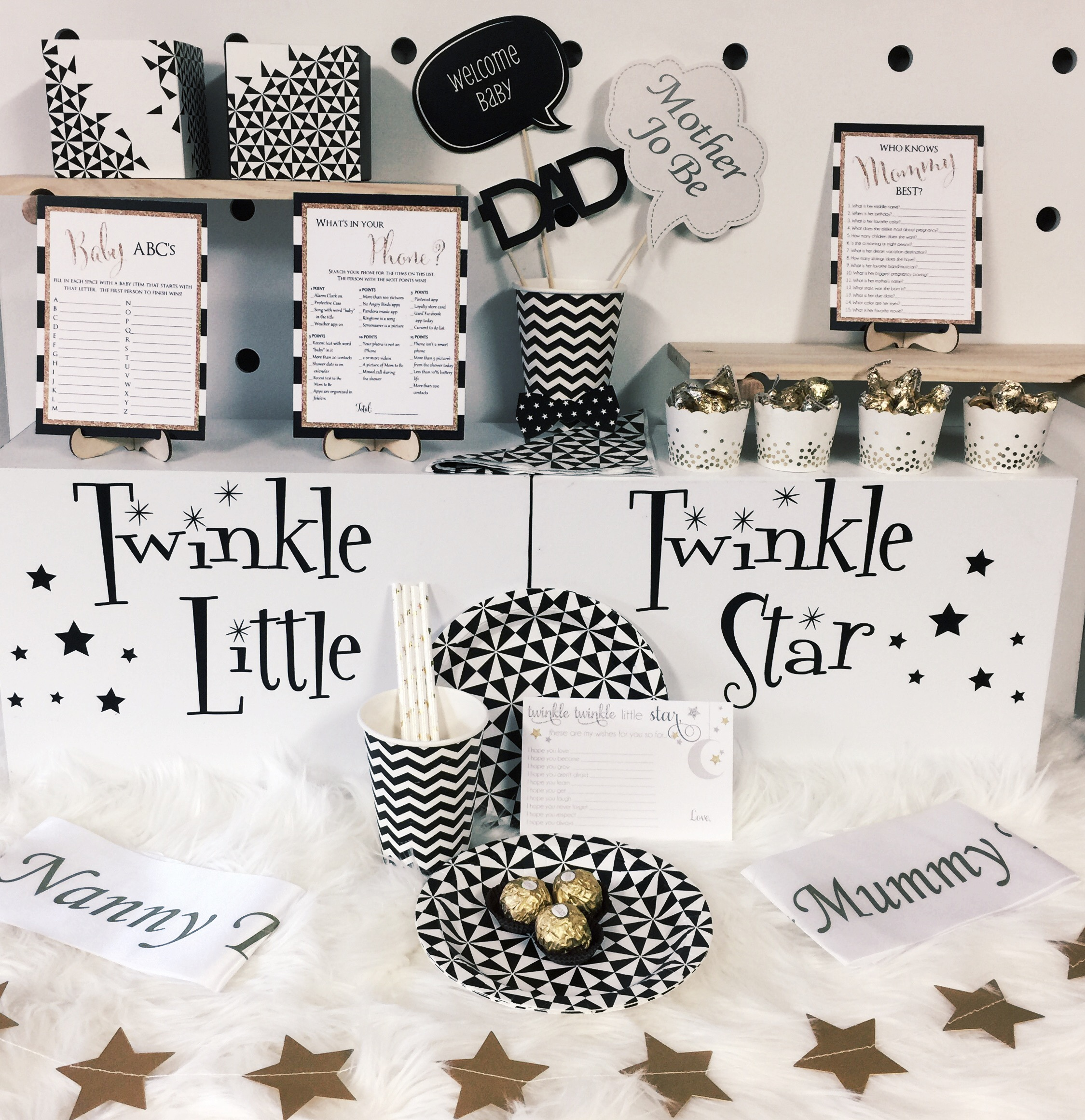 Fully Loaded Twinkle Twinkle Box includes:  12 piece Table setting 10pc Photo Props Gold Star Bunting  Sweet Treats Gift Favour Boxes ready for you to fill Mummy and Nanny to be sashes 12 Baby wish cards Baby Shower Games