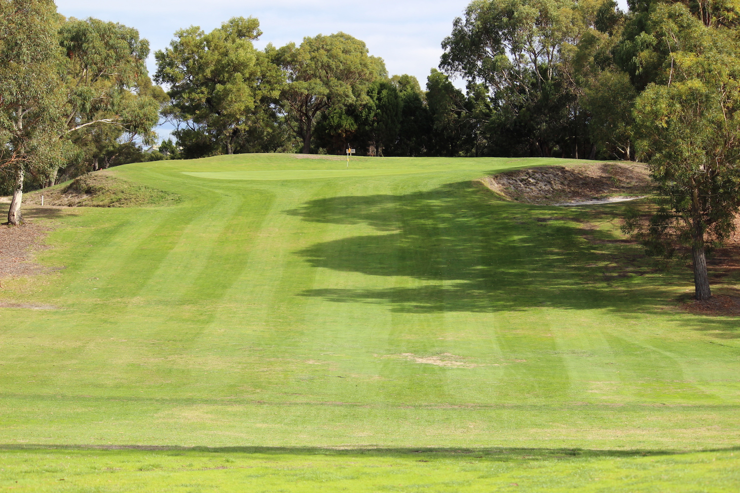 Hole 9    An up hill shot to an elevated small green which is protected by three bunkers and a steep and rough surrounds behind. Requires accuracy to make par.    Men: 105 metres, Par 3, Stroke Index 17   Ladies: 101 metres, Par 3, Stroke Index 17/35