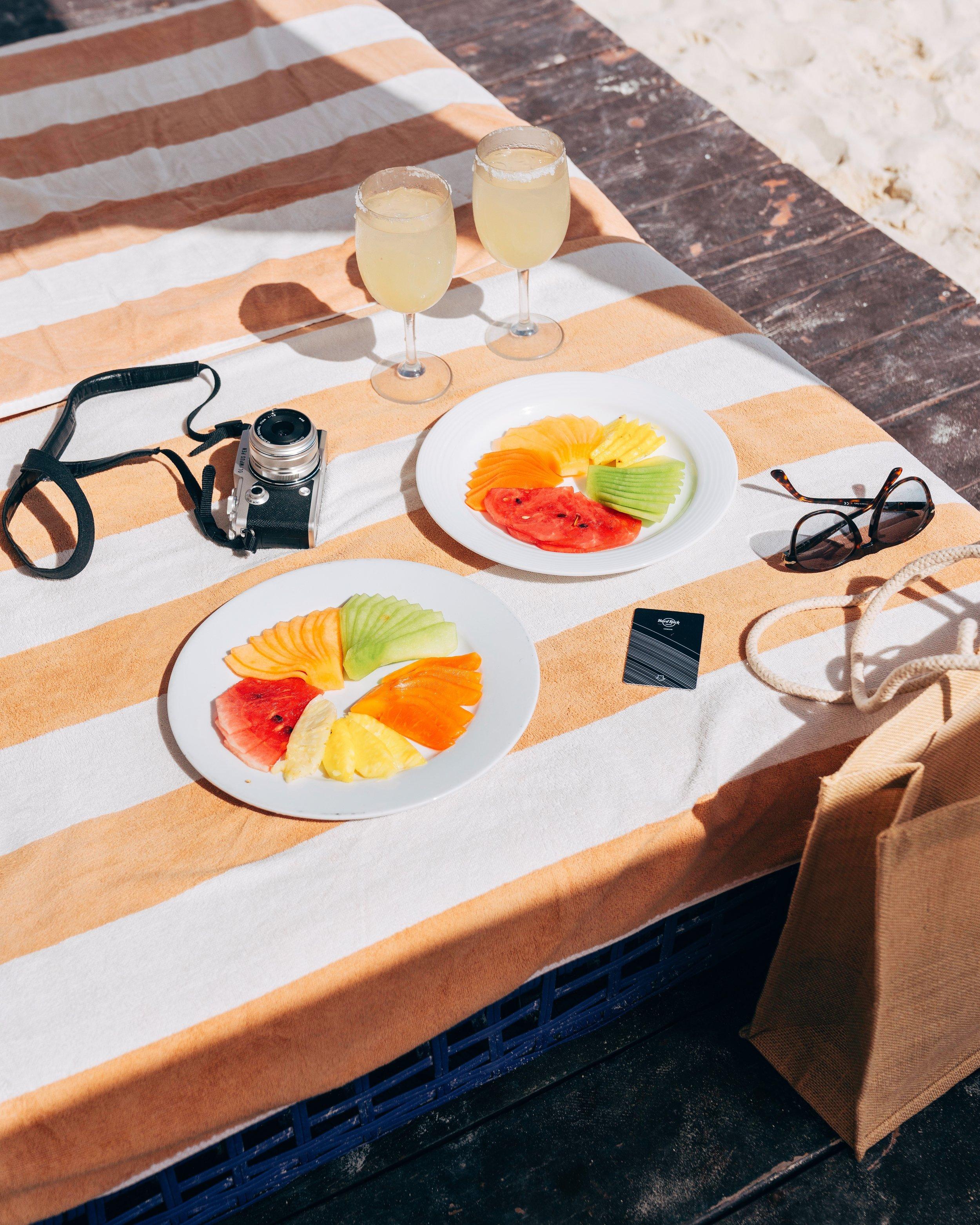 Margaritas and fruit plates -