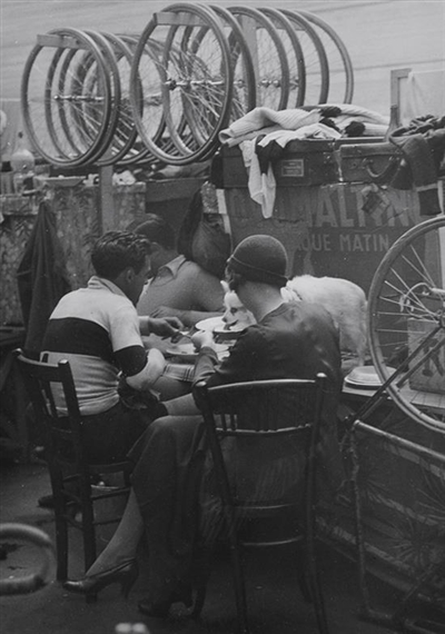 Brassai, (1899-1984), Untitled (Eating at the Velodrome), circa 1932, silver gelatin print
