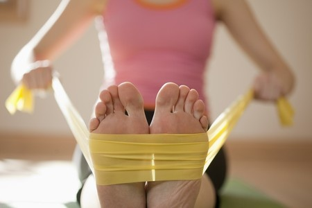 7409657_S_feet_woman_band_stretching_yoga_exercising.jpg