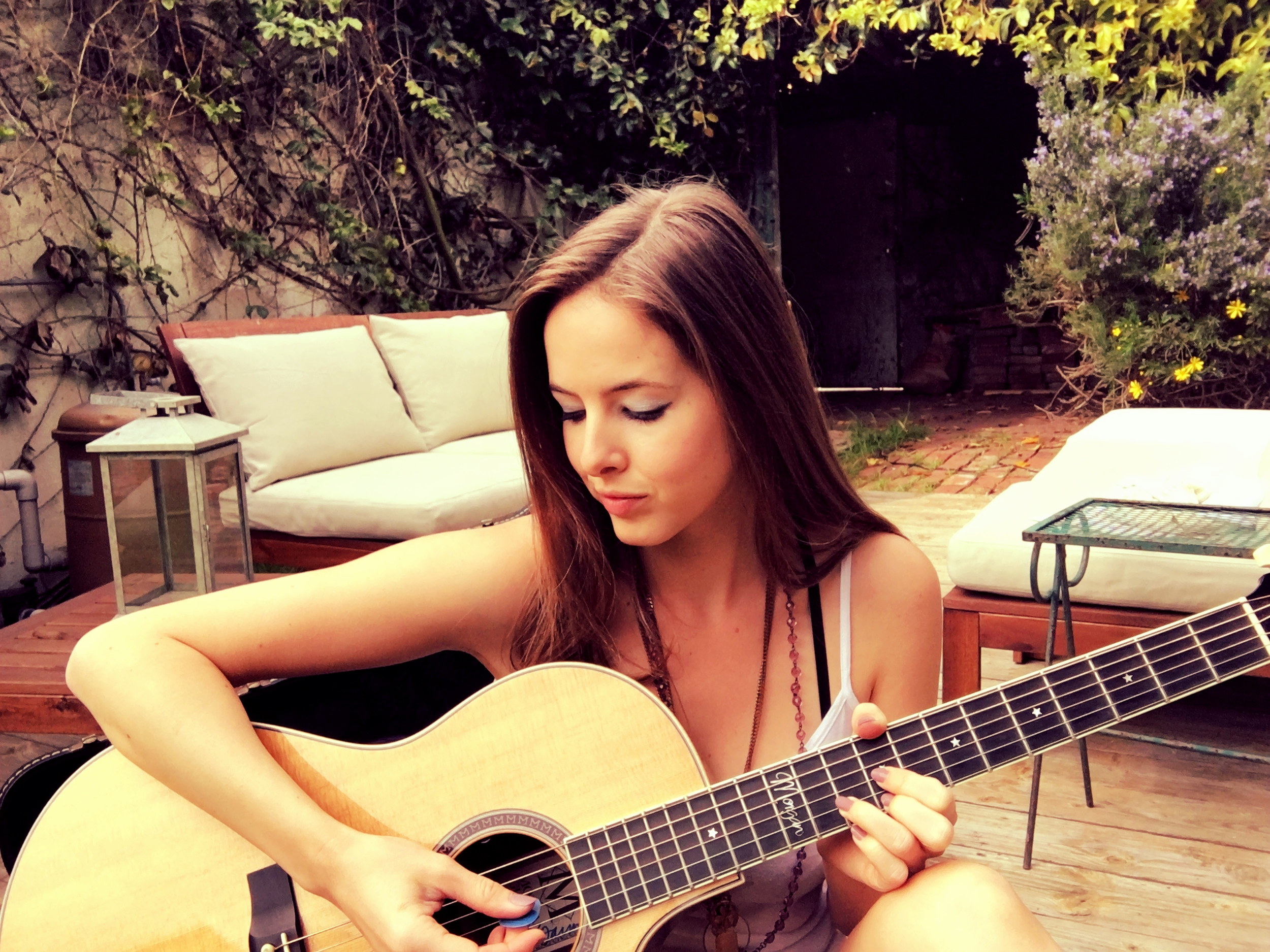 Morgan Ovens plays in the backyard of her home.