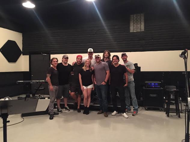 Kimberly with client Jarred Pierce and band at rehearsals. The only woman in the room!
