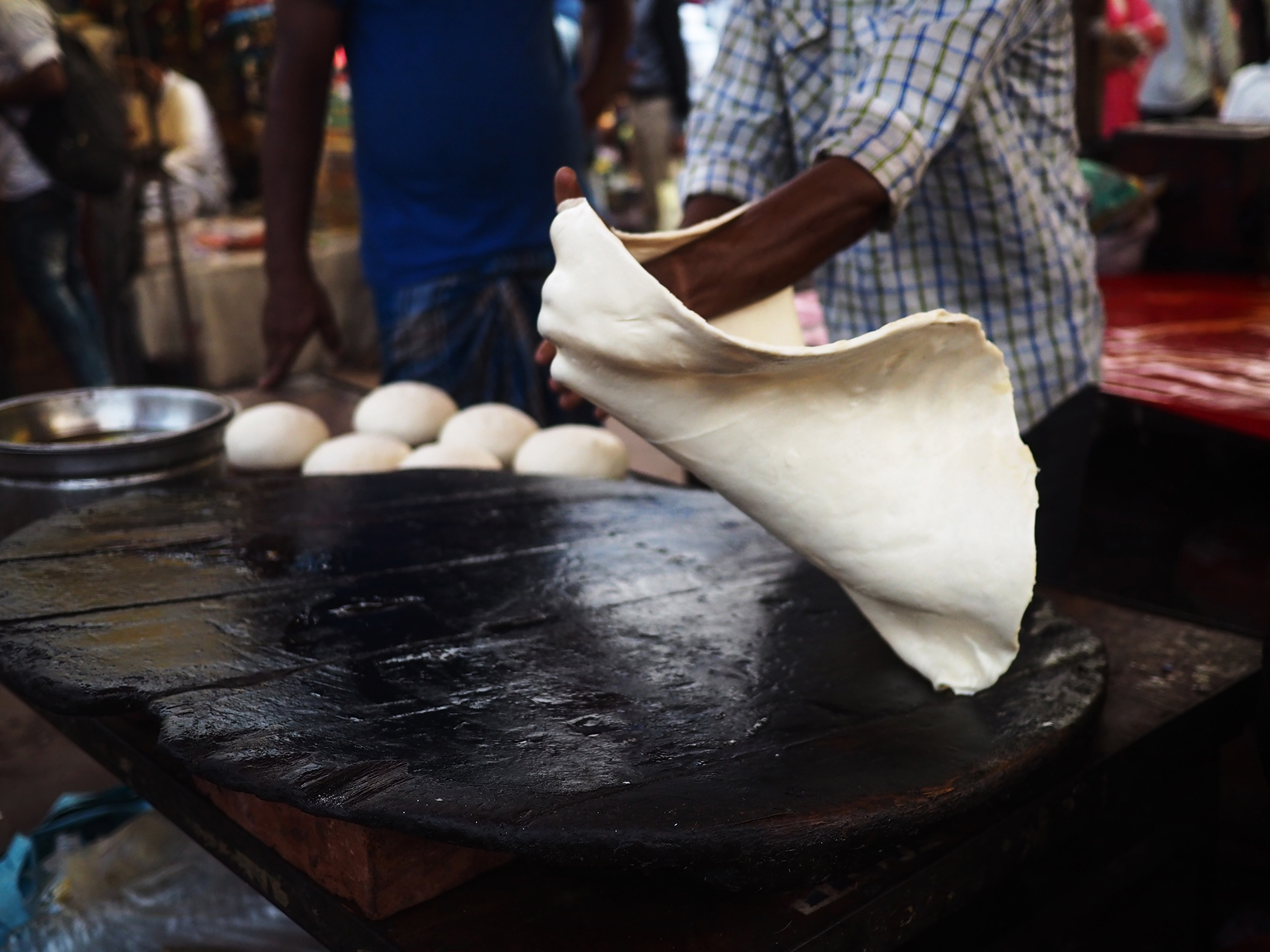 Preparing the enormous, fried, sweet rotis that are eaten with halwa.