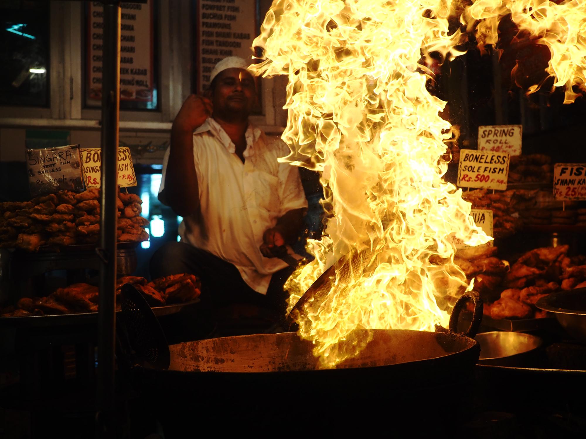 Firing up the kadais to fry kebabs.