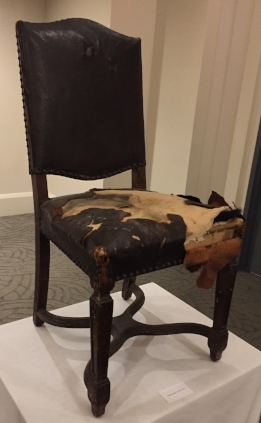 A chair dating to the 1929 opening of the Arcadian Court, looking a bit worse for wear...