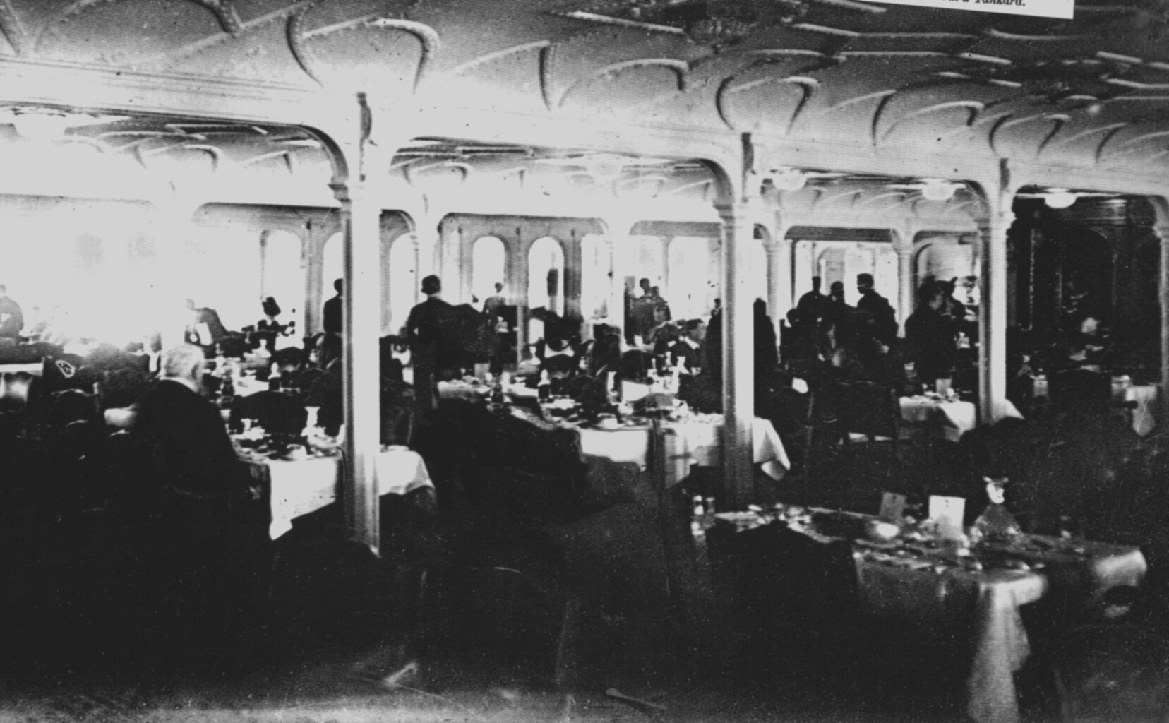 This is the only known photograph taken when the Titanic's First Class Dining Room was in use. It's believed to date from luncheon on April 11th, 1912.