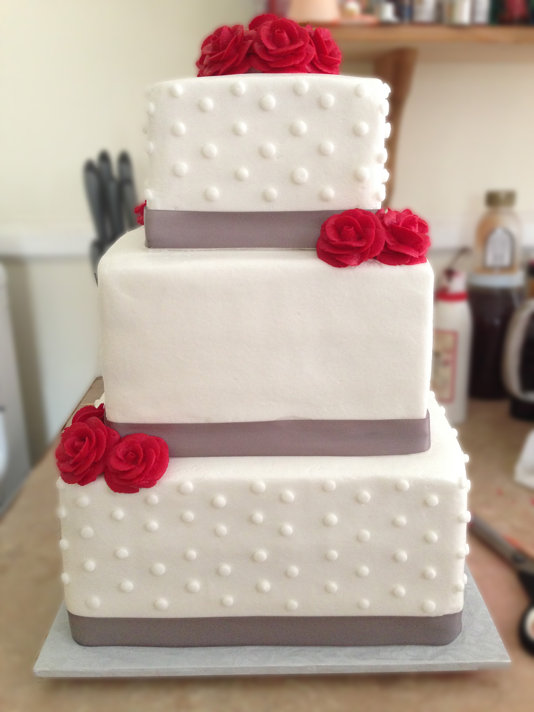 White dotted cake with red and gray accents