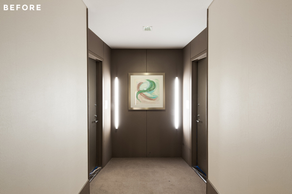 This common hallway before its transformation to a private entry foyer.