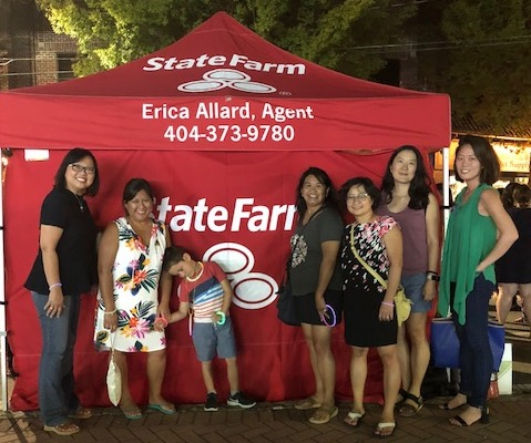 Sue Ann Hong, E.D., Laura Cansicio, Eli Cansicio, Jennifer Cruz, Huong Nguyen, Jennifer Brower, Grace Choi in front of a State Farm tent. State Farm is a major sponsor of CAPAW.