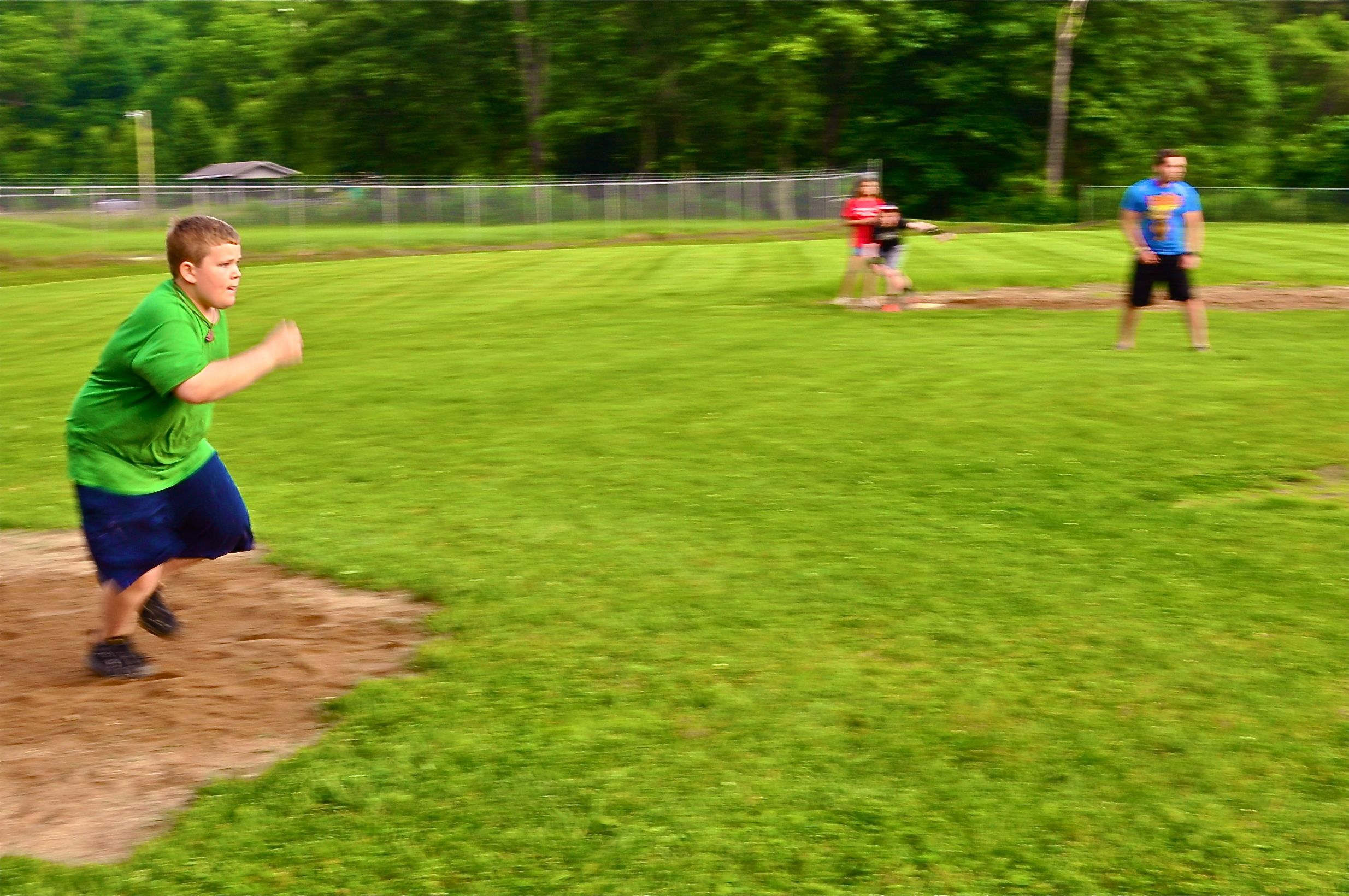 matthew-runs-toward-first-base-after-a-fantastic-kick.jpg