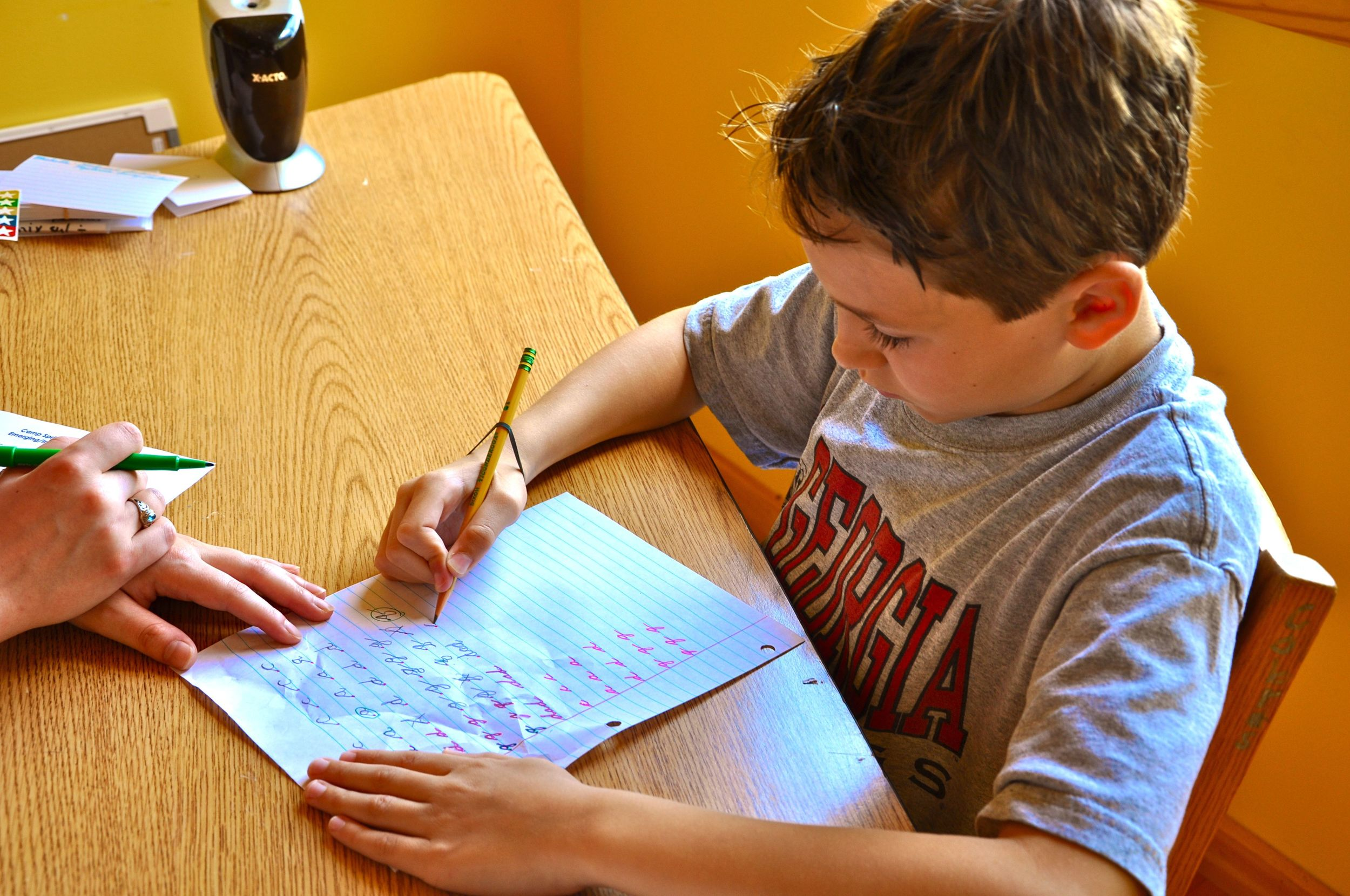 bo-practices-his-cursive-with-sara-in-tutoring.jpg