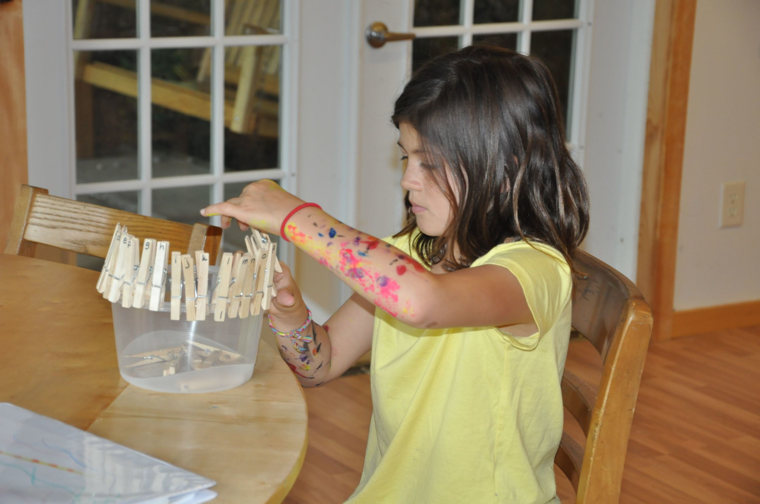 morgan-practices-her-alphabet-despite-the-fact-that-she-is-covered-with-paint.jpg