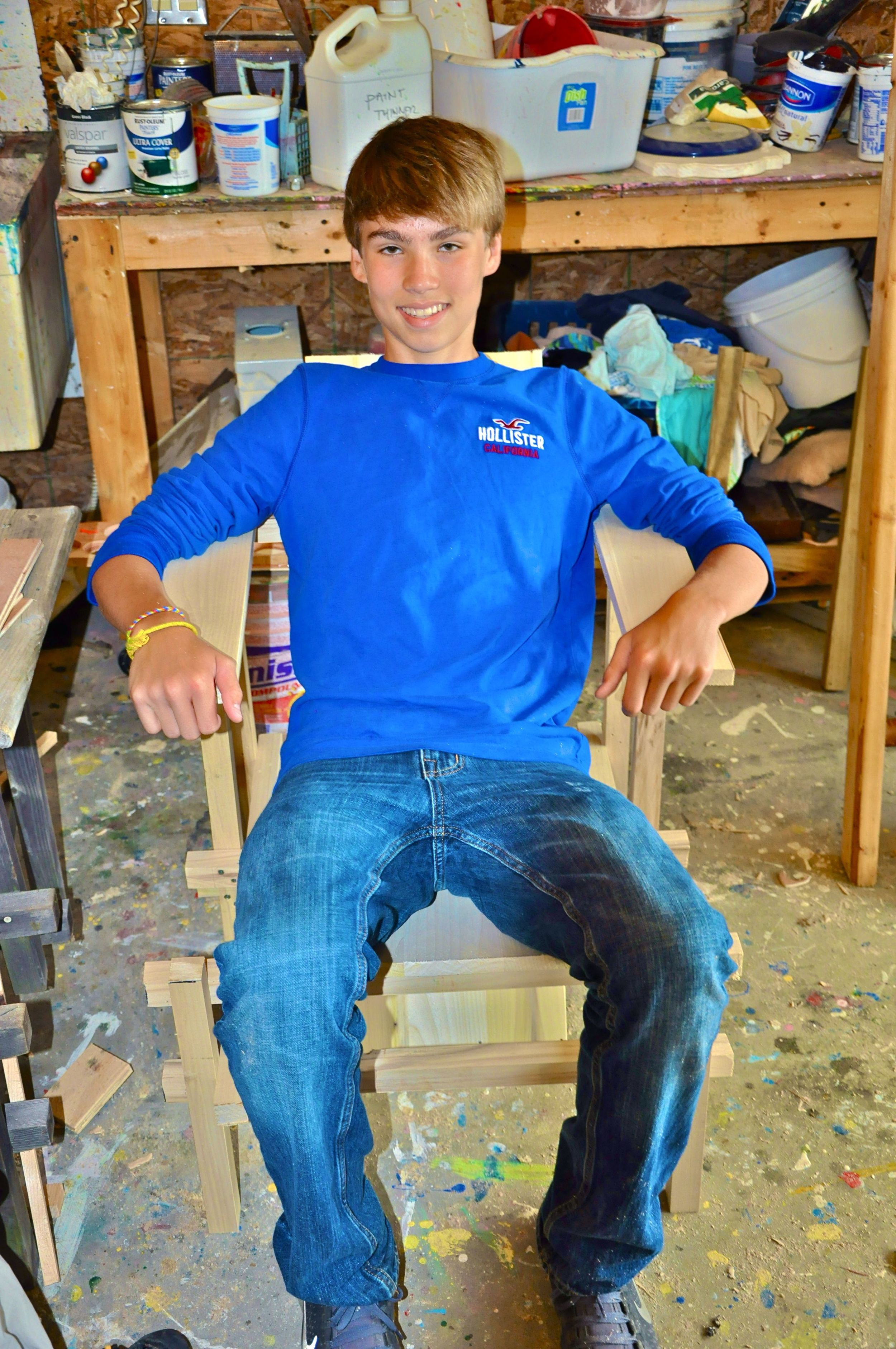 bruce-sitting-in-his-chair-that-he-made-during-woodshop.jpg