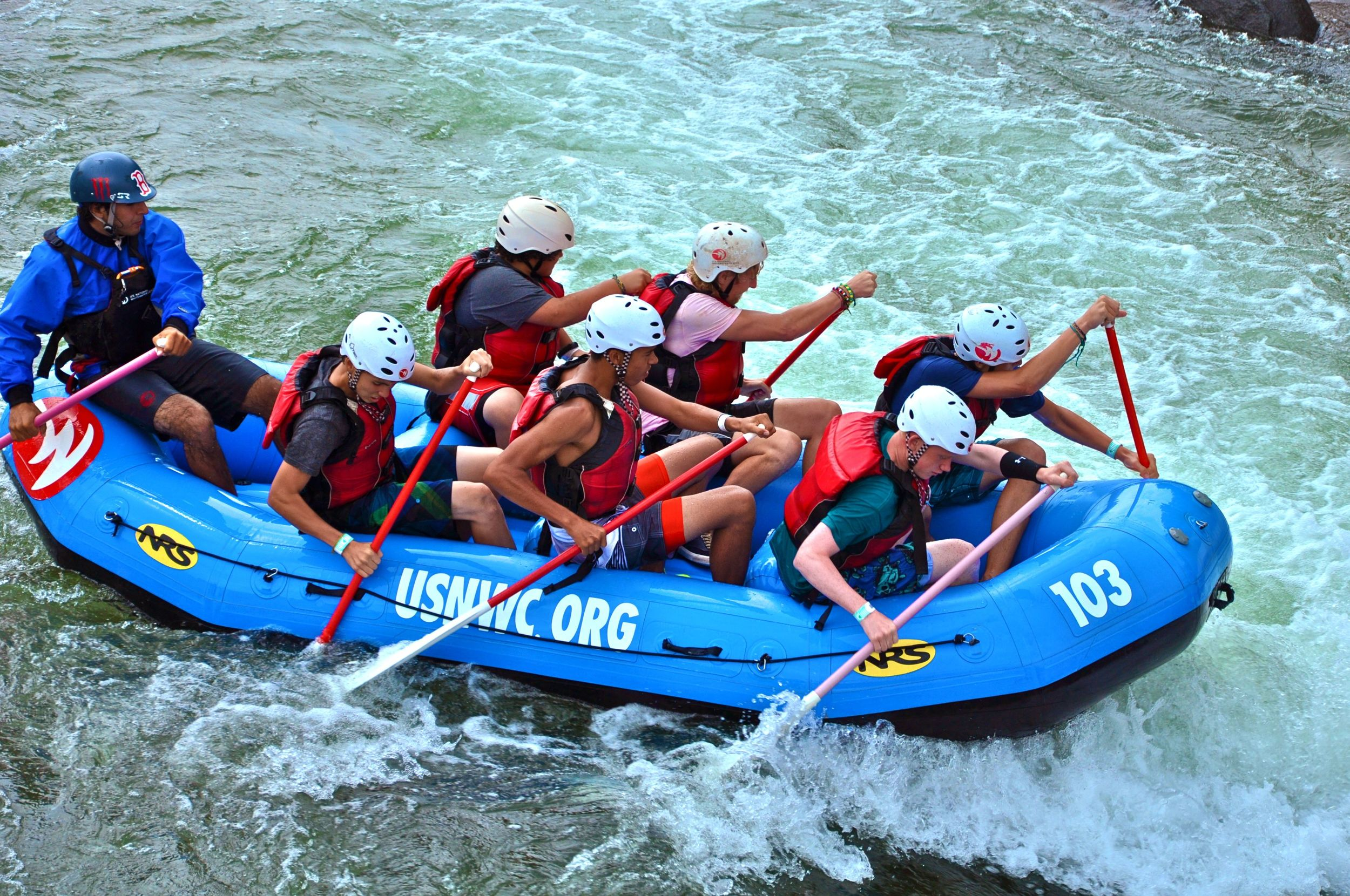 bruce-travis-greg-rob-olson-and-chase-power-into-the-rapids-for-a-speedy-trip-down-the-man-made-river.jpg