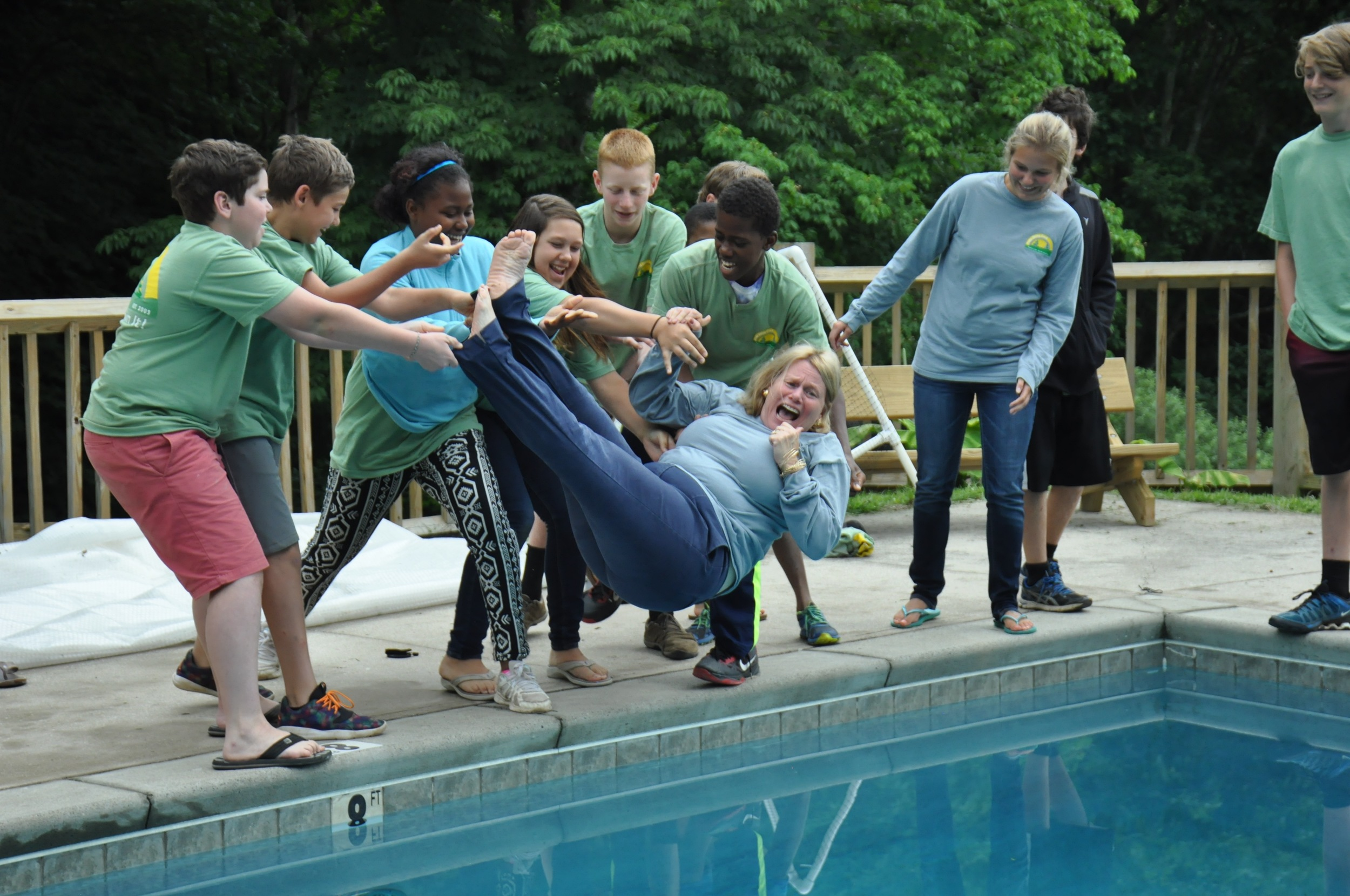 after-the-group-photo-the-campers-planned-a-sneak-attack-to-get-susie-into-the-pool.jpg