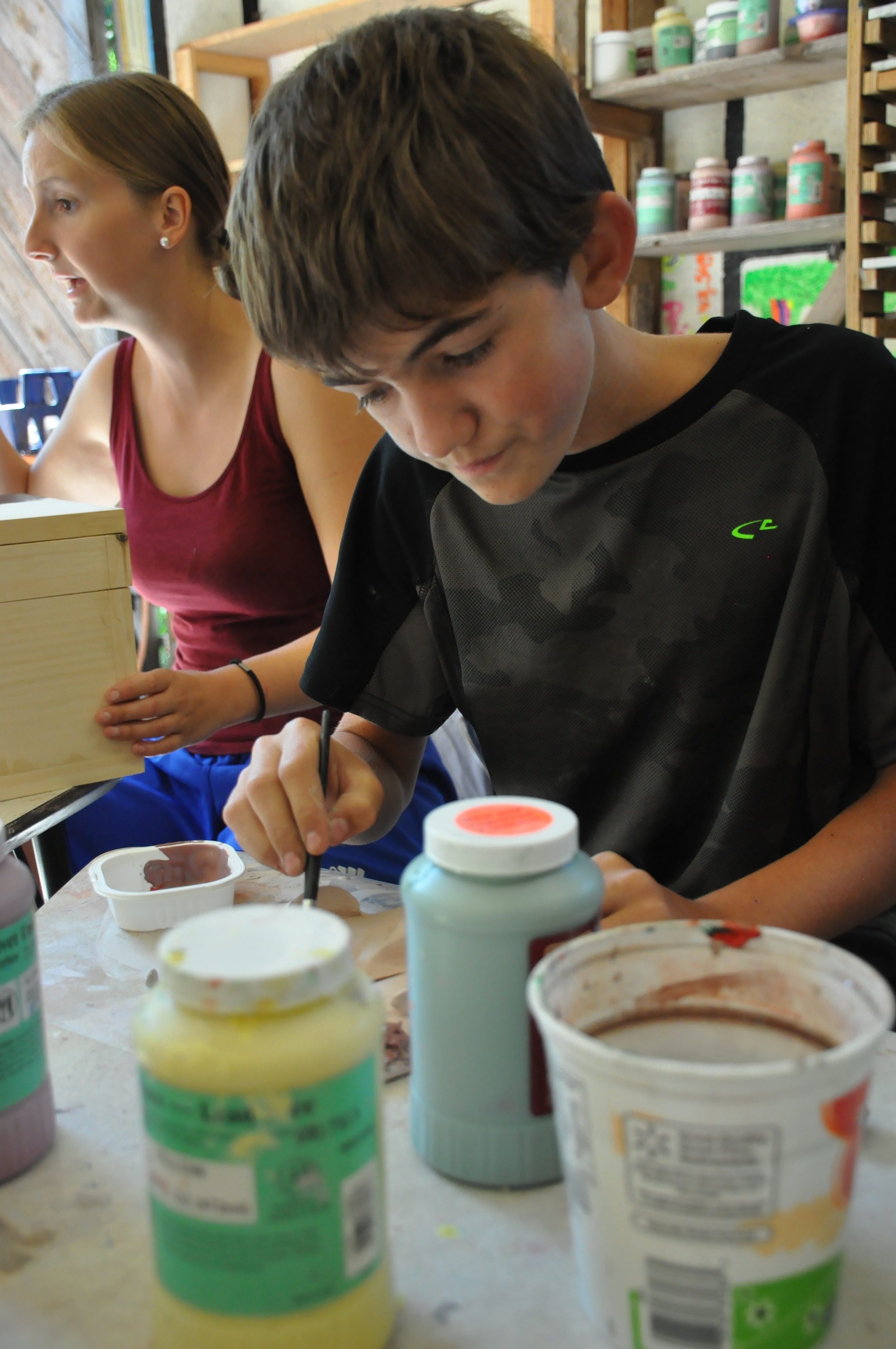 jace-is-glazing-his-clay-during-art.jpg