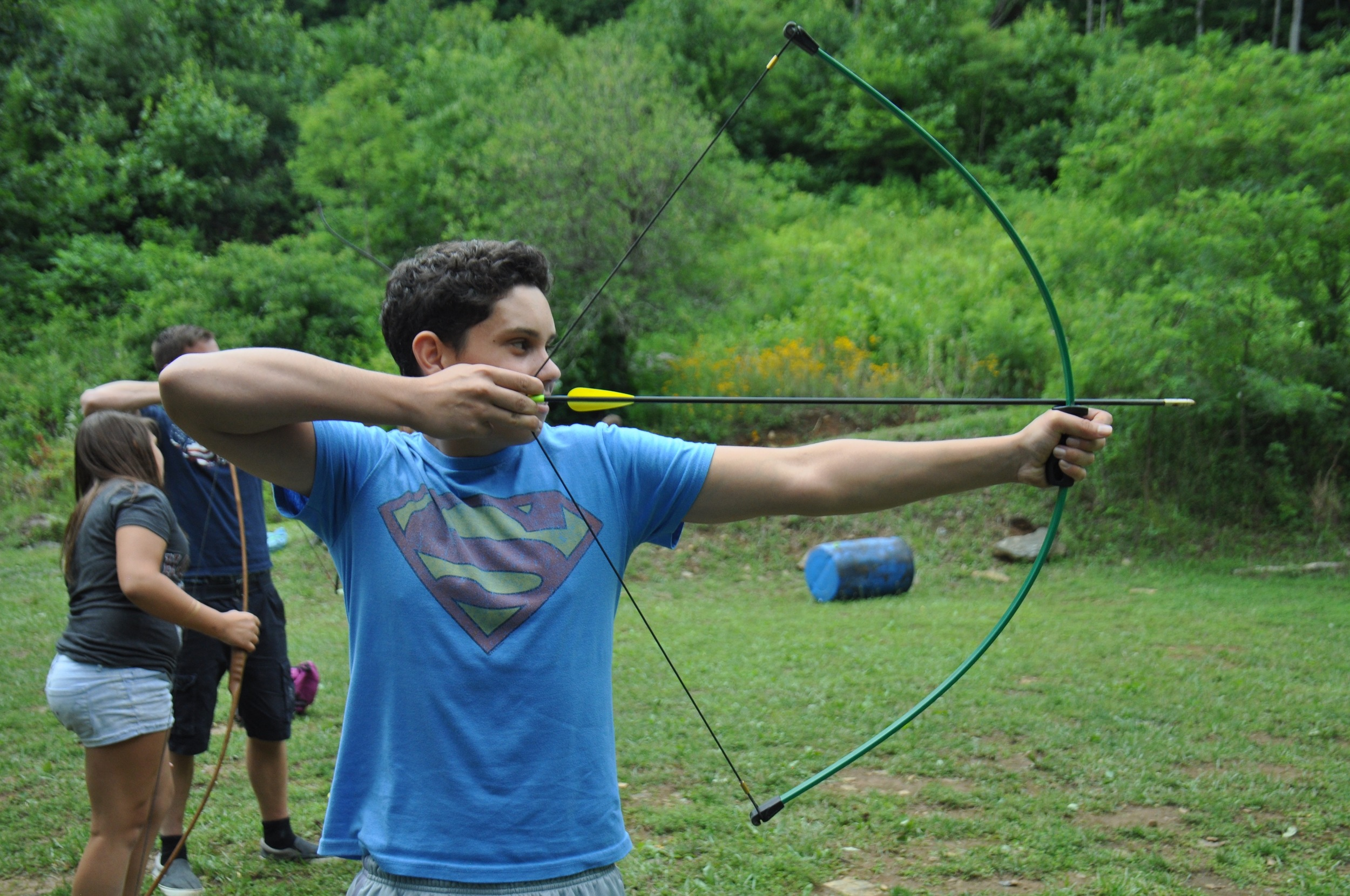 ethan-draws-back-his-bow-and-aims-for-the-bullseye.jpg