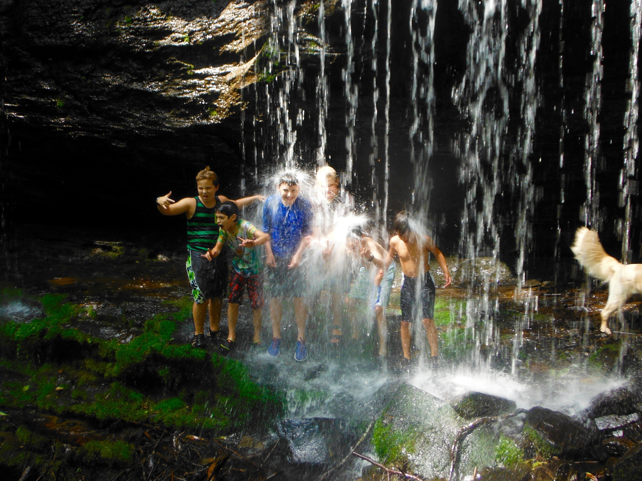 the-junior-boys-get-soaking-wet-under-a-local-waterfall.jpg